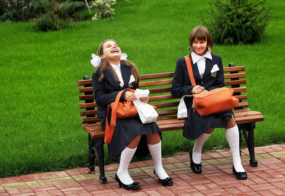 Cadets laugh on the bench in the garden of the Defence Ministry Girls Boarding School on September 9, 2008, in Moscow, Russia