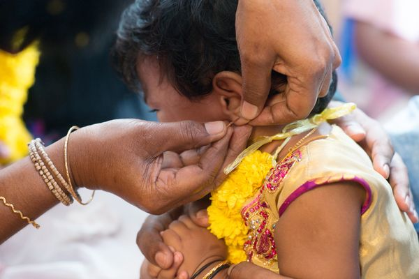 """Some Hindus choose to have their baby's ears pierced in a ritual called <a href=""""http://www.bbc.co.uk/religion/religions/hind"""