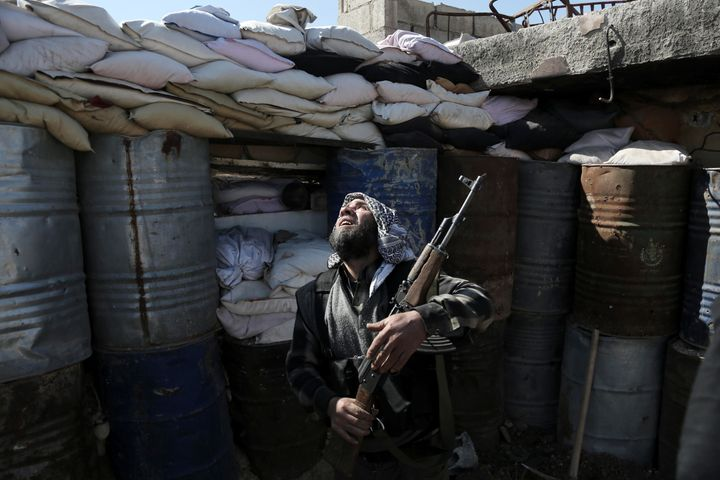 A Syrian rebel fighter from the Failaq al-Rahman brigade mans a position on the frontline against Syrian governmentforc