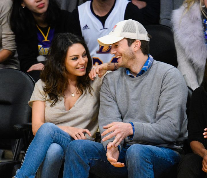 Mila Kunis (L) and Ashton Kutcher attend a basketball game between the Oklahoma City Thunder and the Los Angeles Lakers at St