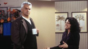 "SEINFELD -- ""The Bookstore"" Episode 17 -- Pictured: (l-r) John O'Hurley as J. Peterman, Julia Louis-Dreyfus as Elaine Benes  (Photo by Joey Delvalle/NBC/NBCU Photo Bank via Getty Images)"