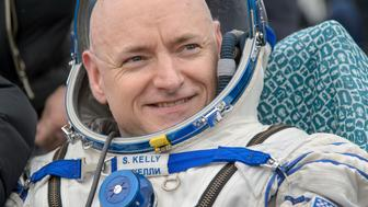 ZHEZKAZGAN, KAZAKHSTAN - MARCH 2: In this handout provided by NASA, Expedition 46 Commander Scott Kelly of NASA rest in a chair outside of the Soyuz TMA-18M spacecraft just minutes after he and Russian cosmonauts Mikhail Kornienko and Sergey Volkov of Roscosmos landed in a remote area on March 2, 2016 near the town of Zhezkazgan, Kazakhstan. Kelly and Kornienko completed an International Space Station record year-long mission to collect valuable data on the effect of long duration weightlessness on the human body that will be used to formulate a human mission to Mars. Volkov returned after spending six months on the station. (Photo by Bill Ingalls/NASA via Getty Images)