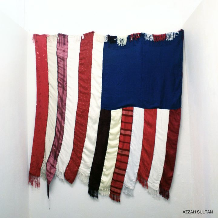 """""""Home Sweet Home"""" is an American flag made ofhijabs from Muslim American women around the country."""