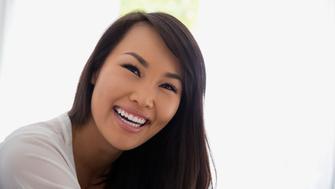 Close up portrait smiling woman black hair