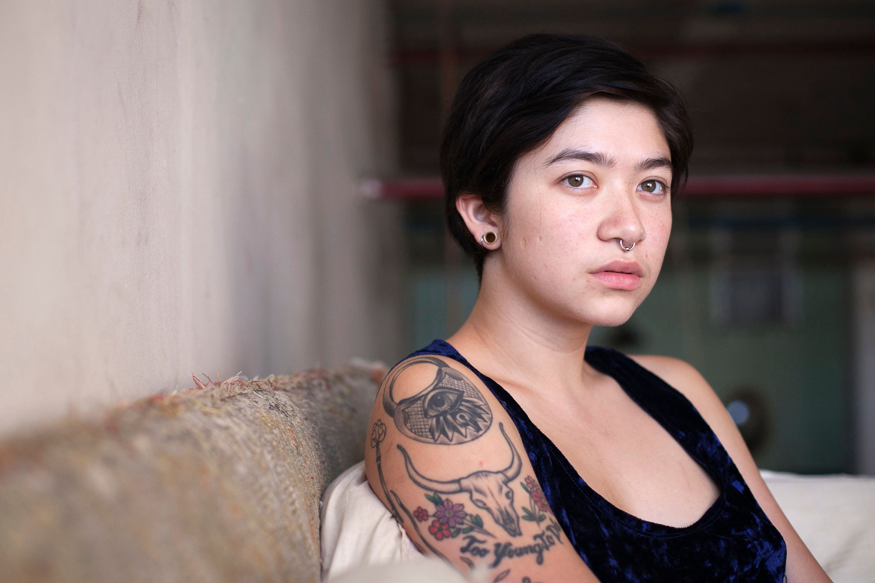 """Aiyana, a 22-year-old artist, poses for a portrait in her home in New York September 21, 2012. Aiyana says she was 20 years old when she became pregnant and had an abortion. """"He ended up not being as supportive as I thought he would be (at the immediate time). He did everything he could, aside from paying for it. I initially paid for everything out of pocket. Although I was reimbursed for it - but to cover the initial costs, I took care of all of that. After it happened, when I did feel like I needed a lot of emotional support, he didn't really provide that. So that was a contributing factor to us breaking up,� Aiyana said. Picture taken September 21, 2012.  REUTERS/Allison Joyce  (UNITED STATES - Tags: SOCIETY) - RTX13R6U"""