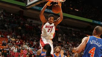 MIAMI, FL - JANUARY 6:  Hassan Whiteside #21 of the Miami Heat dunks against the New York Knicks on January 6, 2016 at American Airlines Arena in Miami, Florida. NOTE TO USER: User expressly acknowledges and agrees that, by downloading and or using this Photograph, user is consenting to the terms and conditions of the Getty Images License Agreement. Mandatory Copyright Notice: Copyright 2016 NBAE (Photo by Issac Baldizon/NBAE via Getty Images)
