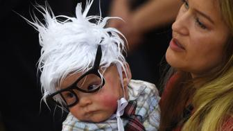 LAS VEGAS, NV - FEBRUARY 14:  Susan Lomas (L) of Nevada holds her 3-month-old son Oliver Lomas, dressed as Democratic presidential candidate Sen. Bernie Sanders (D-VT) during his campaign rally at Bonanza High School on February 14, 2016 in Las Vegas, Nevada. Sanders is challenging Hillary Clinton for the Democratic presidential nomination ahead of Nevada's February 20th Democratic caucus.  (Photo by Ethan Miller/Getty Images)