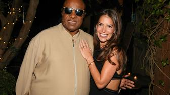 WEST HOLLYWOOD, CA - OCTOBER 08:  Recording artist Stevie Wonder (L) and Divorce Attorney Laura Wasser attend Laura Wasser's Book Party on October 8, 2013 in West Hollywood, California.  (Photo by Imeh Akpanudosen/Getty Images for Laura Wasser)