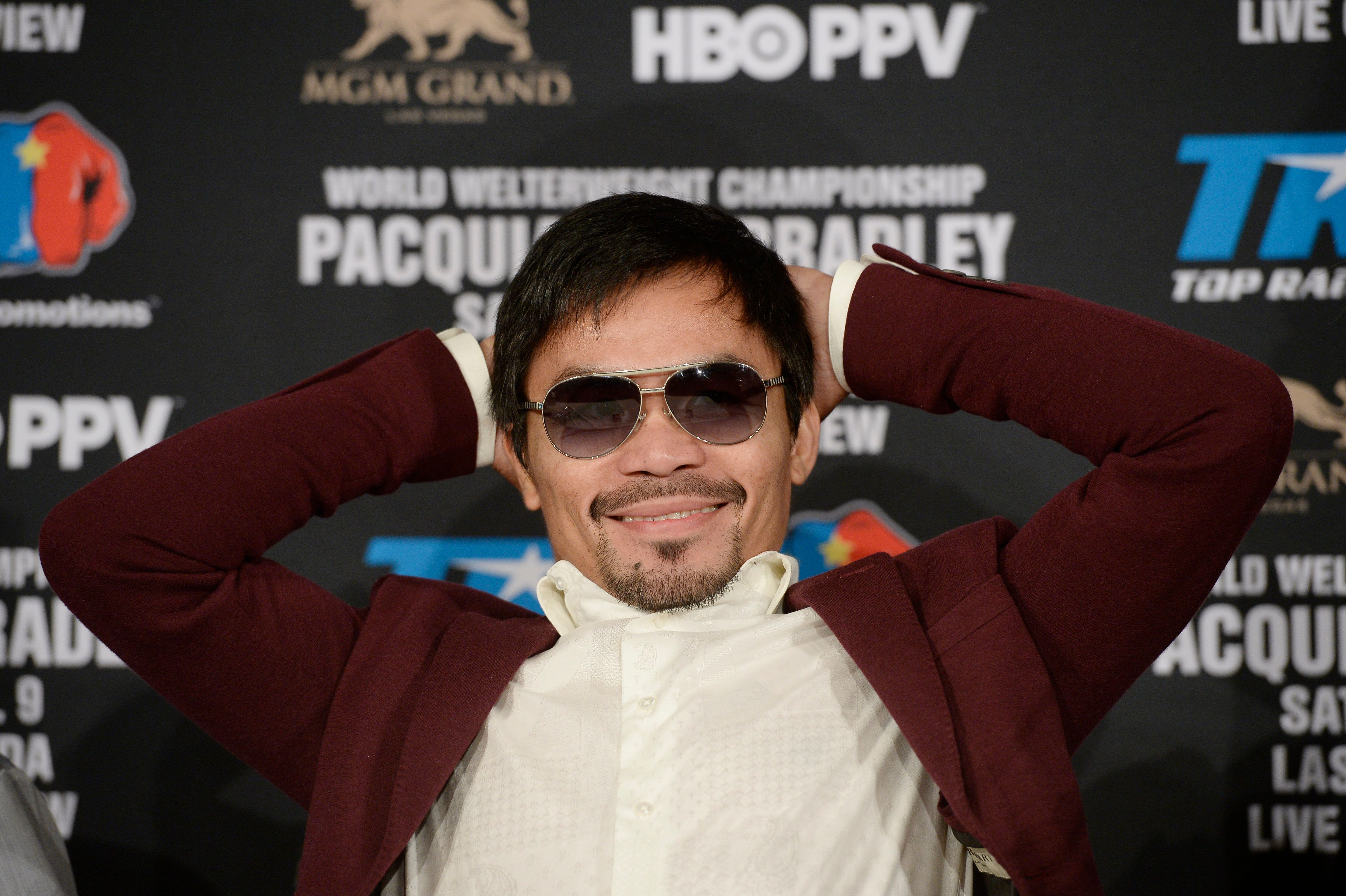 BEVERLY HILLS, CA - JANUARY 19: Manny Pacquiao smiles during a news conference where he announce his upcoming world welterweight championship bout against Timothy Bradley at the Beverly Hills Hotel January 19, 2016 in Beverly Hills, California. The fight will take place at the MGM Grand casino in Las Vegas, Nevada, on April 9. (Photo by Kevork Djansezian/Getty Images)