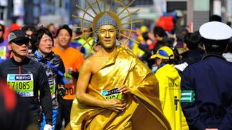 TOKYO, JAPAN - FEBRUARY 28 : Runners cross Tokyo city as they compete in the Tokyo Marathon on February 28, 2016 in Tokyo, Japan. Thousands people take part in the Tokyo Marathon 2016, also serves as selection Race of Japan Men's Marathon Representatives for the Rio 2016 Olympic Games (Photo by David Mareuil/Anadolu Agency/Getty Images)