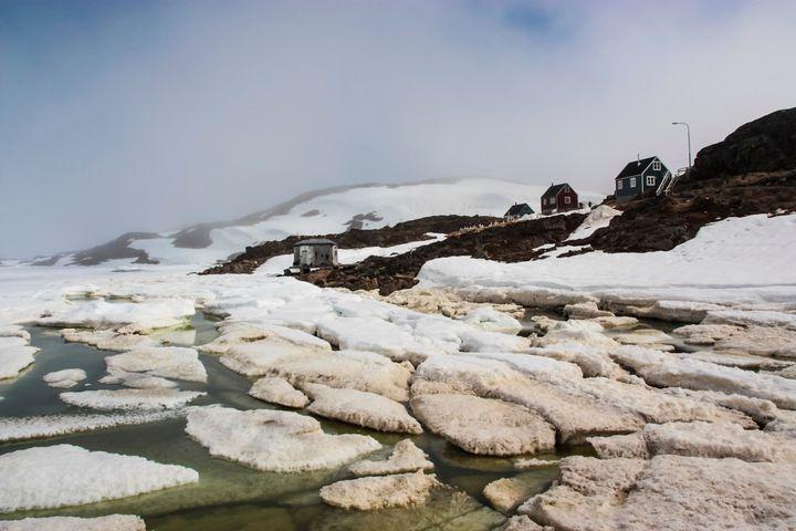 Dirty sea ice breaking up inKulusuk, Greenland.