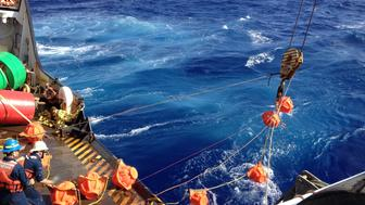 Deployment of deep-ocean hydrophone mooring from deck of  USCG Cutter Sequoia at Mariana Trench.