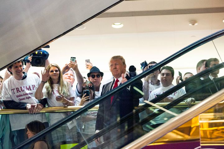 Business mogul Donald Trump rides an escalator to a press event to announce his candidacy for the U.S. presidency at Trump To