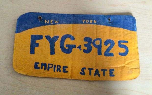 A New York woman was caught driving with this homemade license plate on the back of her vehicle.
