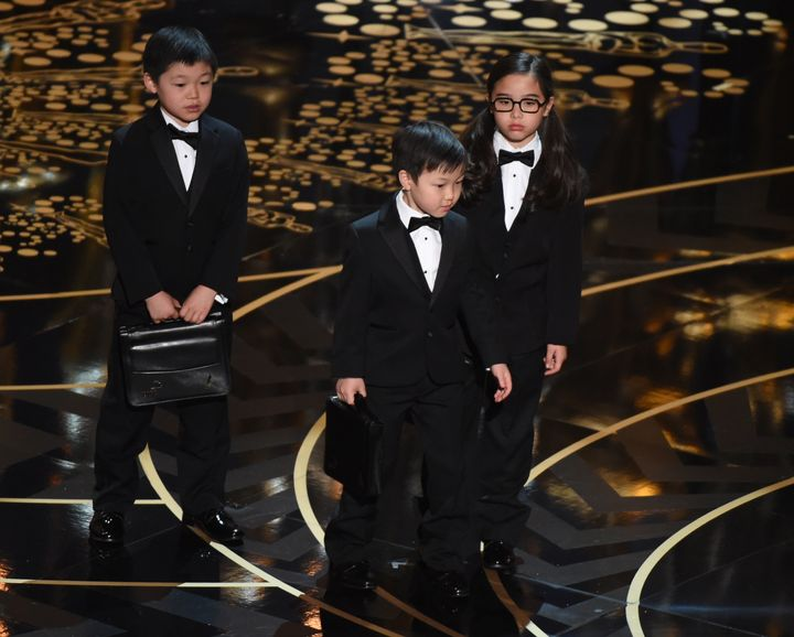 Children represent accountants from PricewaterhouseCoopers on stage at the 88th Oscars on February 28, 2016 in Hollywood, Cal