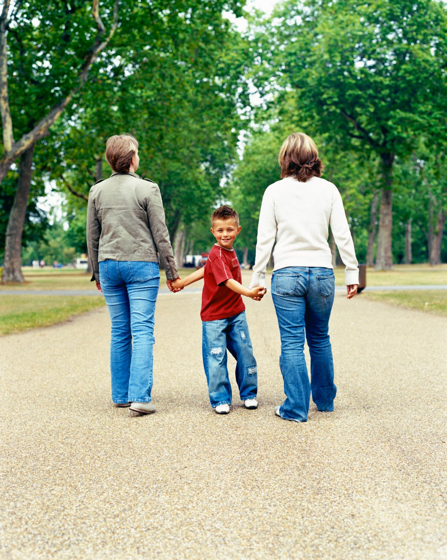 Couple and child walking and holding hands