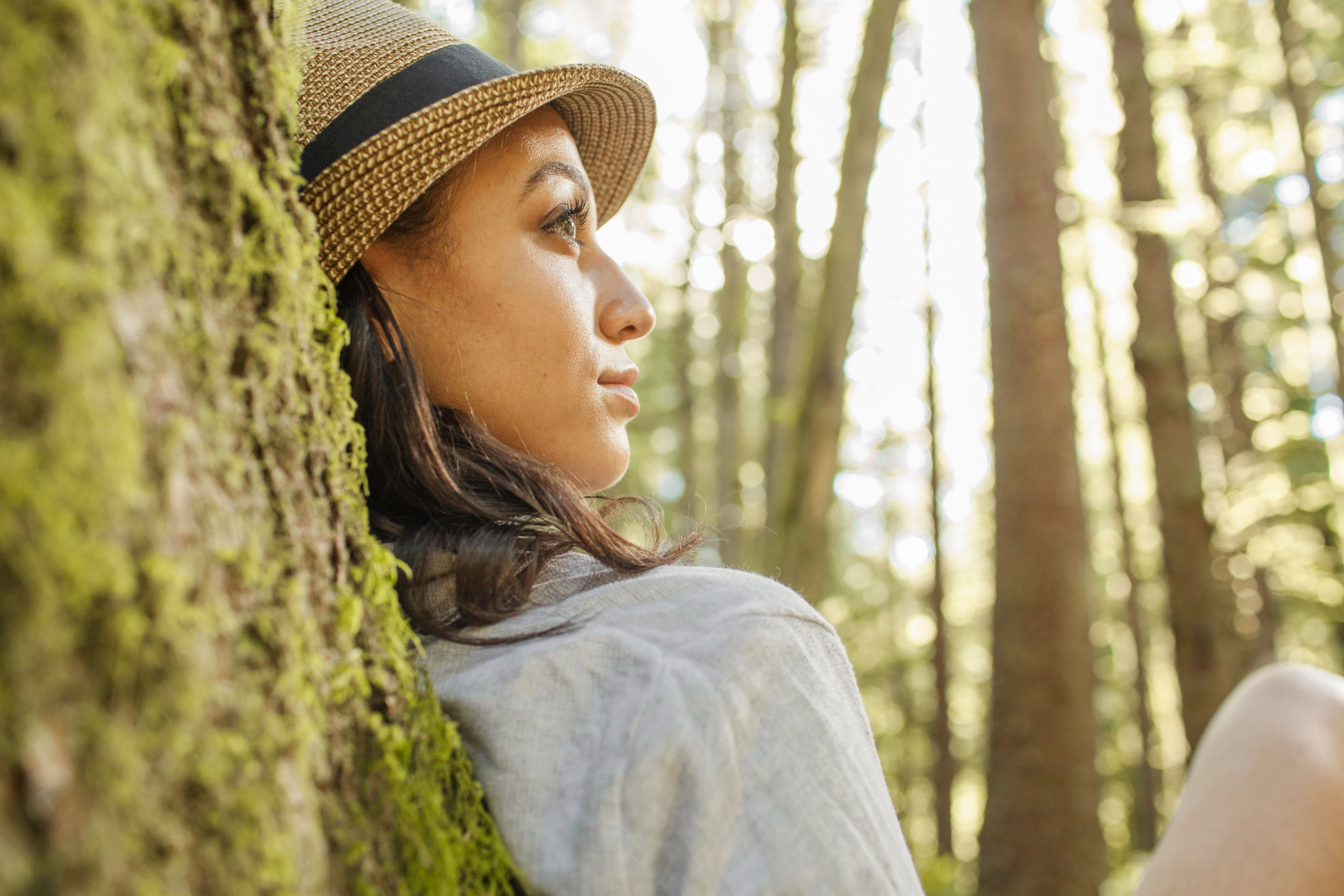 Close-up Portrait of Woman sitting in Tree