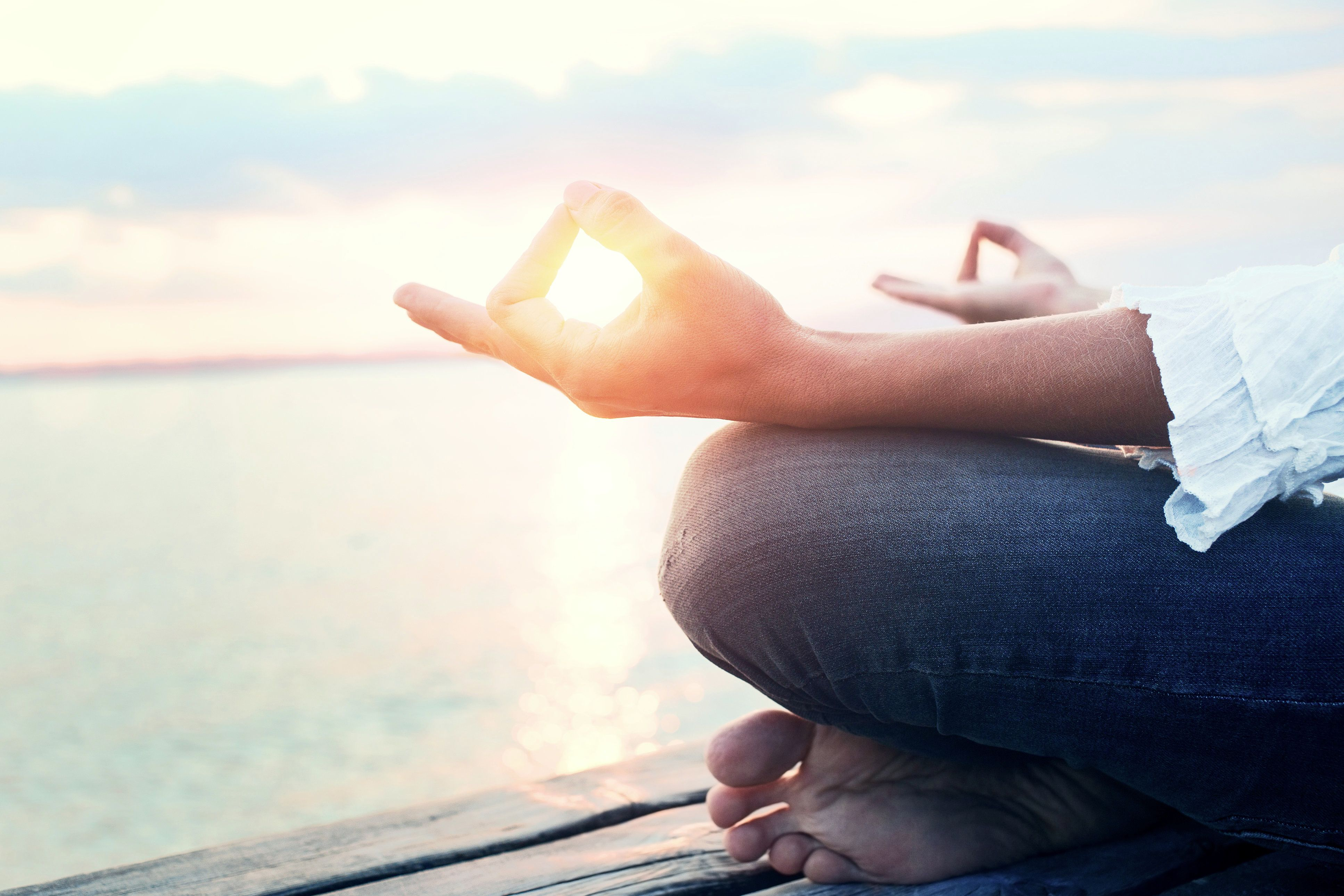 Peaceful woman finding body and mind balance