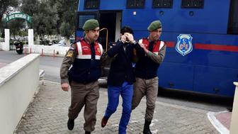 MUGLA, TURKEY - MARCH 2 :  Turkish gendarmeries escort 2 Syrians, arrested on suspicion of causing deaths of 5 refugees including Aylan Kurdi,as they brought to the court in Mugla, Turkey on March 2, 2016. Aylan Kurdi,3 year old kid drowned after boat sank on route to the Greek islands in the Aegean Sea.    (Photo by Ali Balli/Anadolu Agency/Getty Images)