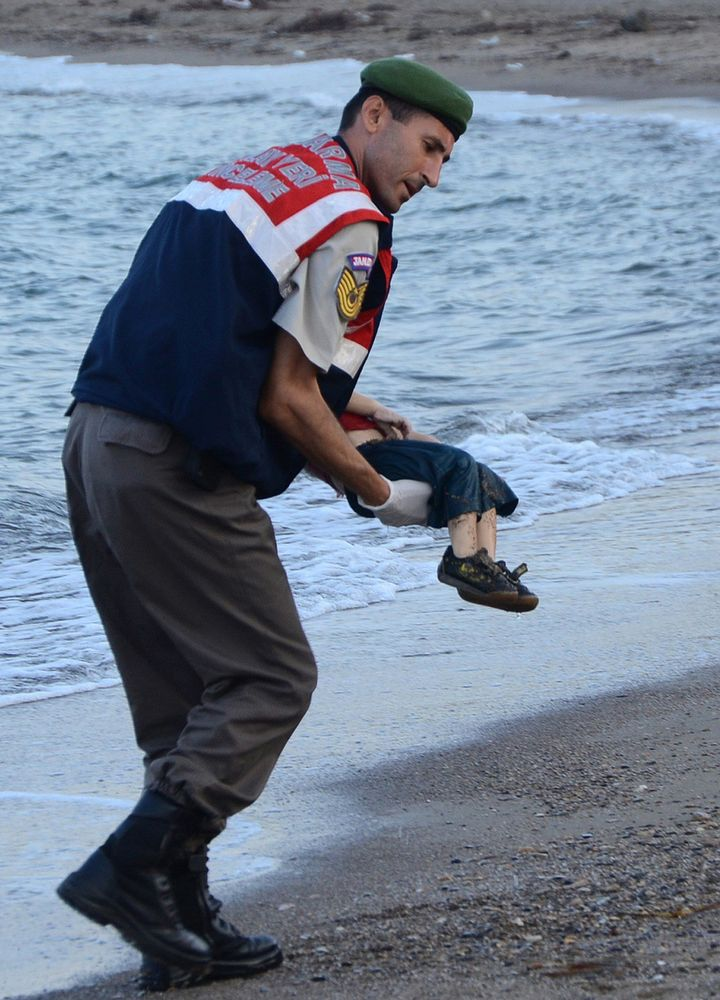 A Turkish police officer carriedAylan Shenu's body off the shores in Bodrum on Sept. 2, 2015.