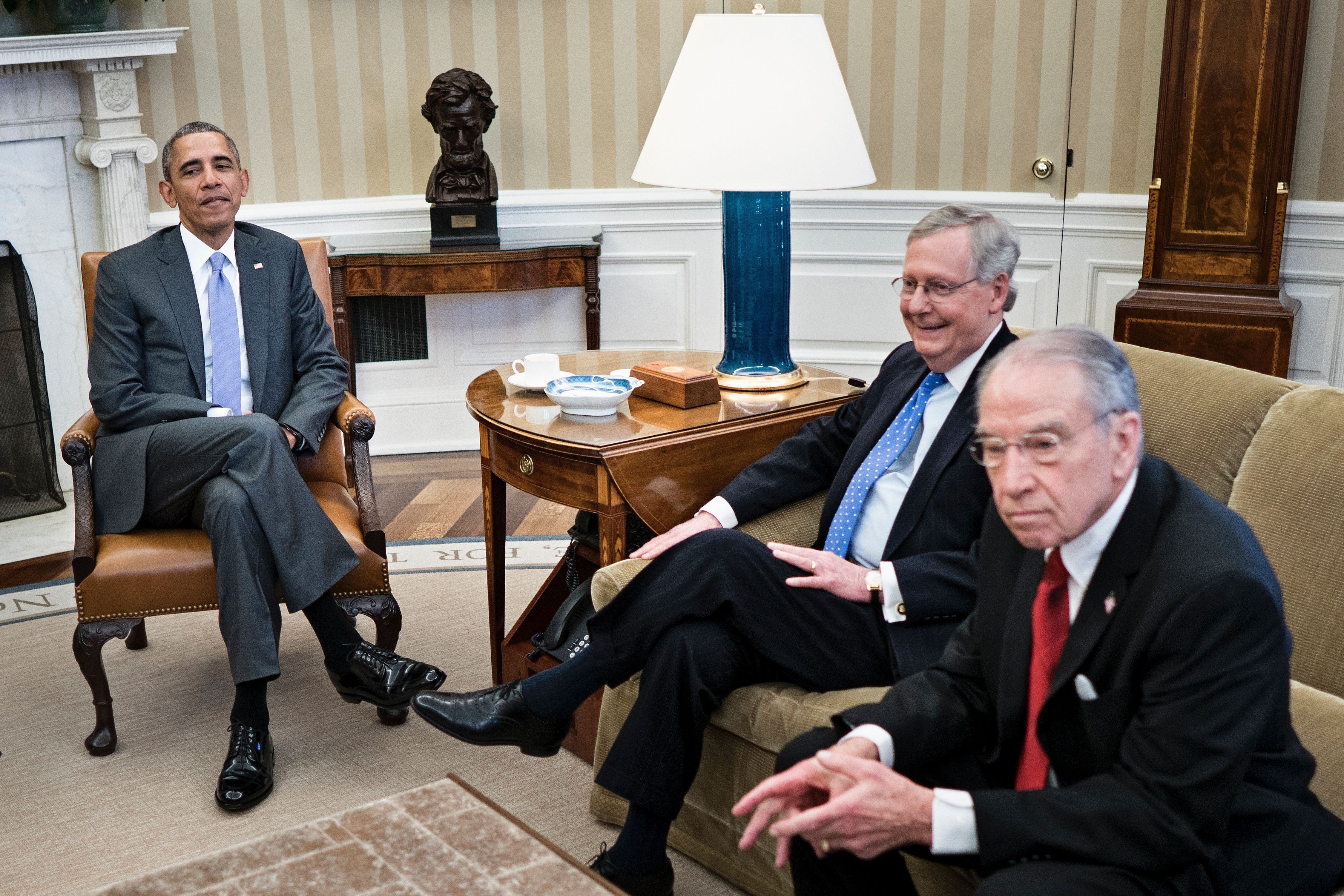 From left: US President Barack Obama, Senate Majority Leader Senator Mitch McConnell (R-KY) and Senator Chuck Grassley (R-IA) wait to begin a meeting about the Supreme Court vacancy in the Oval Office of the White House March 1, 2016 in Washington, DC. / AFP / Brendan Smialowski        (Photo credit should read BRENDAN SMIALOWSKI/AFP/Getty Images)