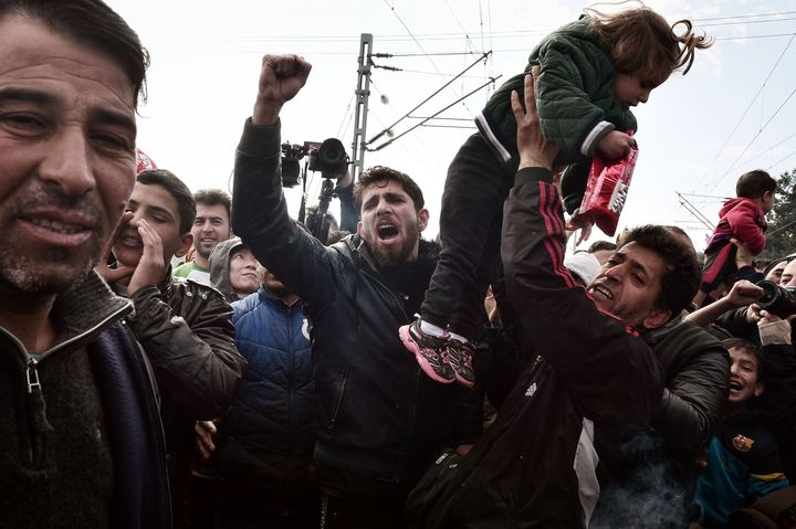 Protesters block a train coming from Macedonia at the overcrowded makeshift refugee camp in the Greek border town of&nbs