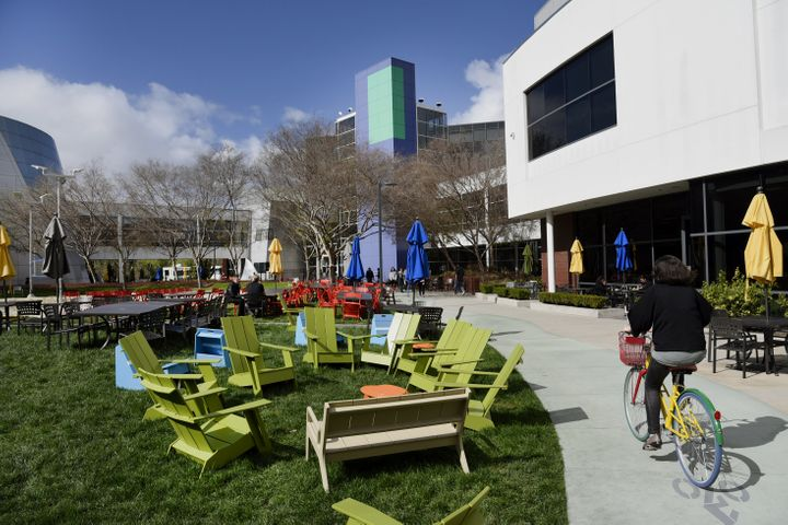A cyclist rides past Google Inc. offices inside the Googleplex headquarters in Mountain View, Calif.