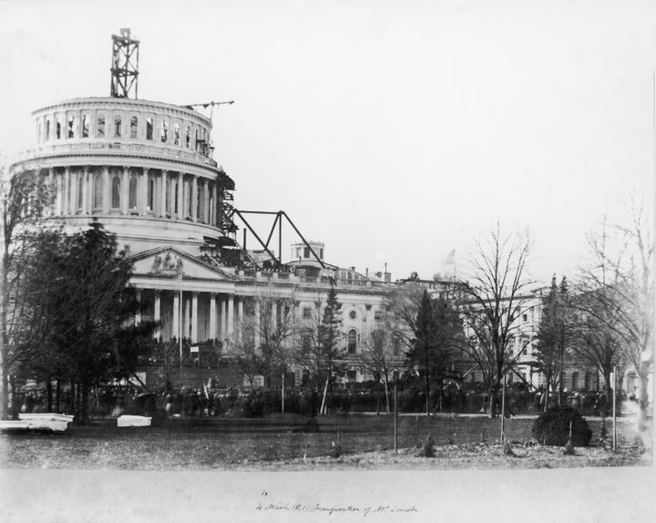 A viewof the United States Capitol Building, showing the dome under construction, on the day of the first inauguration