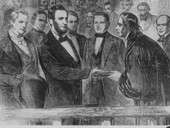 An engraving depictsChief Justice Taney administering the oath to President Abraham Lincoln at his inaugurationon