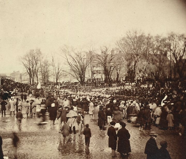 Acrowd of people waiting during President Abraham Lincoln's second inauguration, which was held on a rainy day at the U