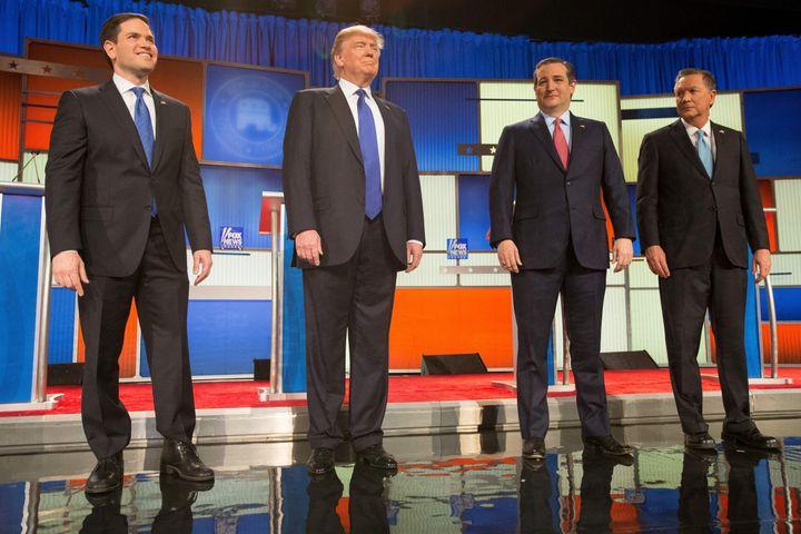Sen. Marco Rubio (R-Fla.), Donald Trump, Sen. Ted Cruz (R-Texas) and Ohio Gov. John Kasich pose for a photo at the beginning&