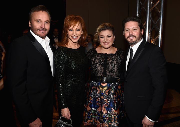 Narvel Blackstock, his ex-wife Reba McEntire, son Brandon Blackstock and his wife Kelly Clarkson