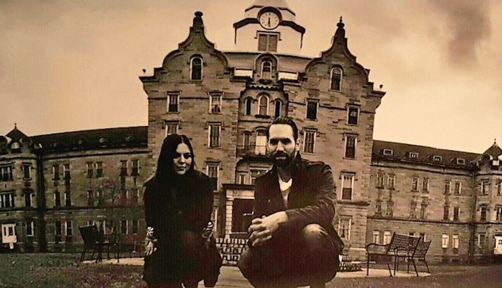 """Paranormal Lockdown"" investigators Katrina Weidman and Nick Groff in front of the abandoned Trans-Allegheny Lunatic Asylum i"
