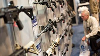 Rifles hang on display in the Colt's Manufacturing Co. booth on the exhibition floor of the 144th National Rifle Association (NRA) Annual Meetings and Exhibits at the Music City Center in Nashville, Tennessee, U.S., on Saturday, April 11, 2015. Top Republican contenders for their party's 2016 presidential nomination are lining up to speak at the annual NRA event, except New Jersey Governor Chris Christie and Kentucky Senator Rand Paul, who were snubbed by the country's largest and most powerful gun lobby. Photographer: Daniel Acker/Bloomberg via Getty Images