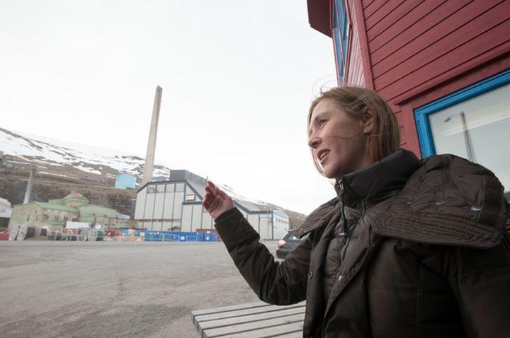 Elisabeth Larsen stands across the street from Longyearbyen's coal burning power plant.