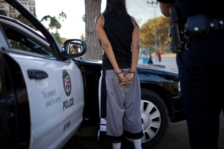 Los Angeles Police Department gang unit officers question an alleged Mara Salvatrucha street gang member on Sept. 1