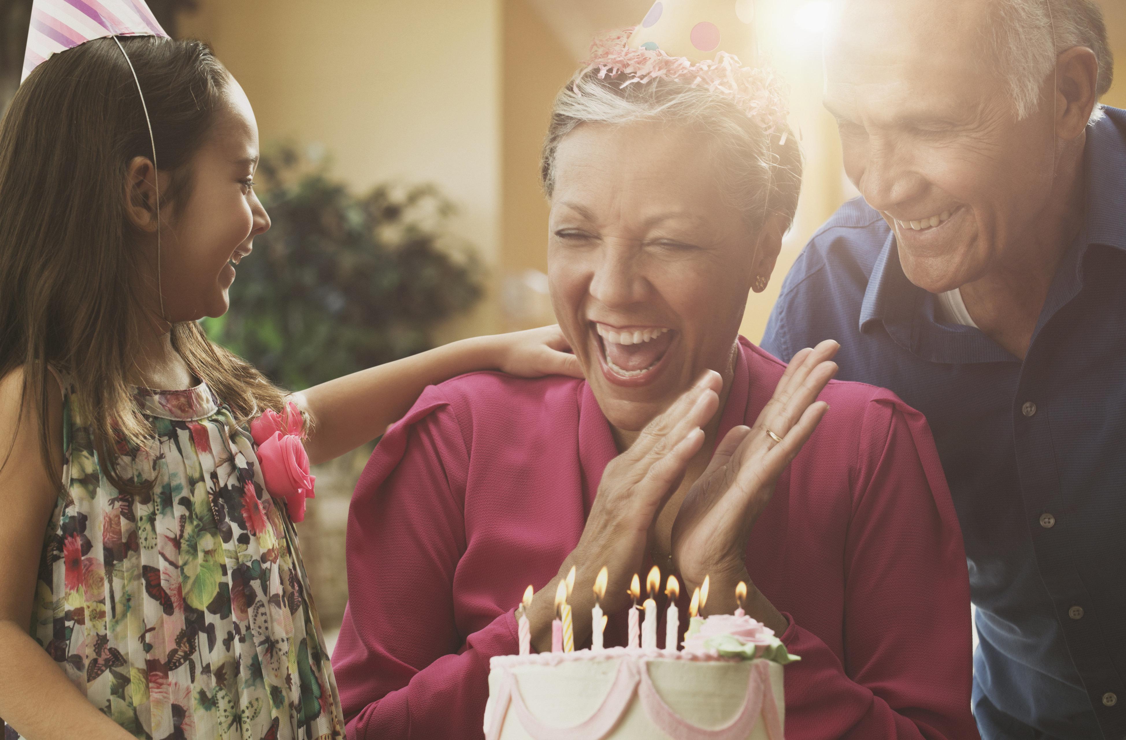 Grandparents and granddaughter celebrating birthday