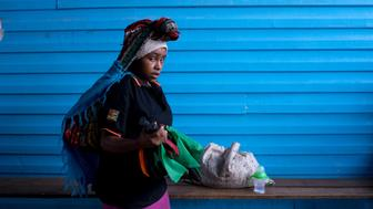 A young woman arrives at Tari Hospital in Papua New Guinea's Hela Province with twins. Their young mother and a friend walked four hours to the clinic so the girls could undergo hernia surgery.