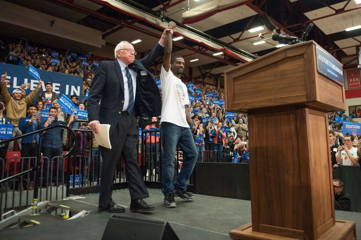 Sen. Bernie Sanders (I-Vt.) with activist Bruce Franks, who announced at the rally inside Southern Illinois University Edward