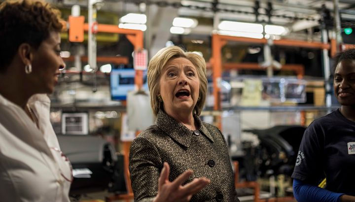 Hillary Clinton toured an automotive parts company before a campaign event in Detroit on Friday.