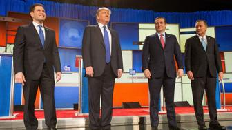US Republican Presidential candidates (L-R) Marco Rubio, Donald Trump, Ted Cruz and John Kasich pose for a photo at start of the Republican Presidential Debate in Detroit on March 3, 2016. / AFP / Geoff Robins        (Photo credit should read GEOFF ROBINS/AFP/Getty Images)