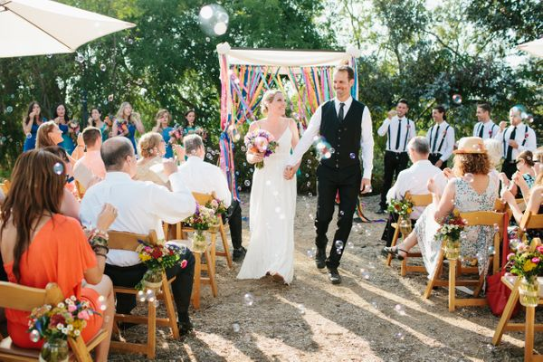 2 use colorful streamers to punch up an outdoor ceremony space backyard wedding ideas