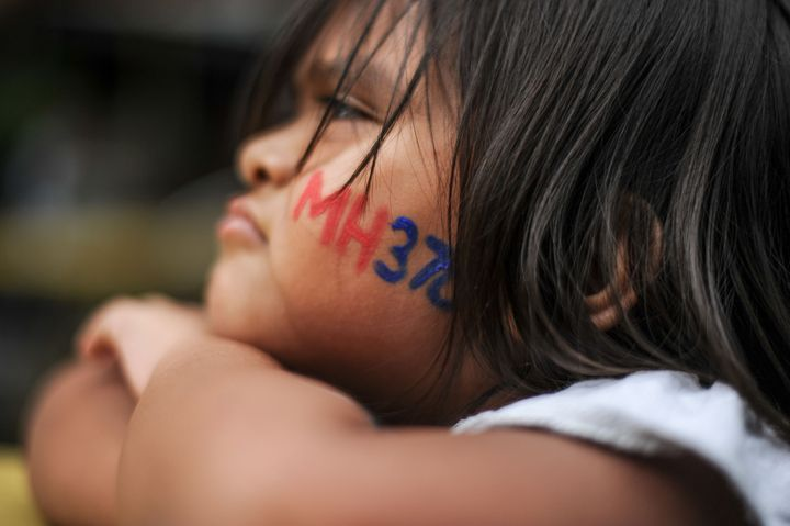 A child attends a remembrance ceremony for flight MH370 in Kuala Lumpur, Malaysia, this week.