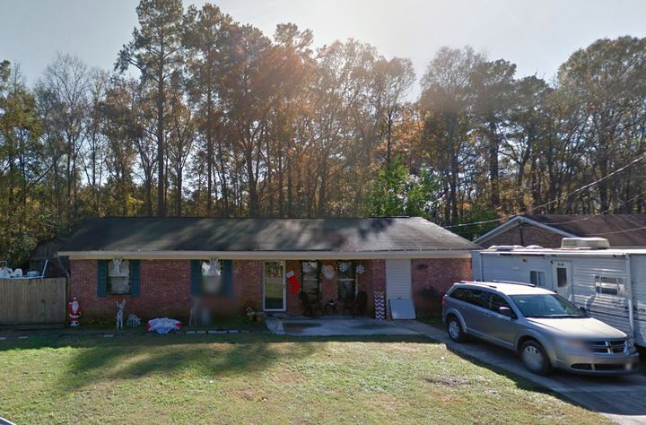Police say the bodies of two men were found buried behind this South Carolina home.