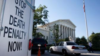 "A vehicle parked near the Supreme Court in Washington, has signage that says ""Stop The Death Penalty Now,"" Monday June 29, 2015. The Supreme Court is meeting for the final time until the fall to decide three remaining cases and add some new ones for the term that starts in October. The three remaining cases that are expected to be decided Monday raise important questions about a controversial drug that was implicated in botched executions, state efforts to reduce partisan influence in congressional redistricting and costly Environmental Protection Agency limits on the emission of mercury and other toxic pollutants from power plants. (AP Photo/Jacquelyn Martin)"