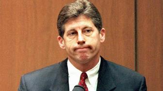 Los Angeles Police Detective Mark Fuhrman sits on  the witness stand for testimony during the double murder trial of O.J. Simpson, Fuhrman has been accused by the defense of being a racist and planting a bloody glove at the Simpson residence. (Photo by Kim Kulish/AFP/Getty Images)