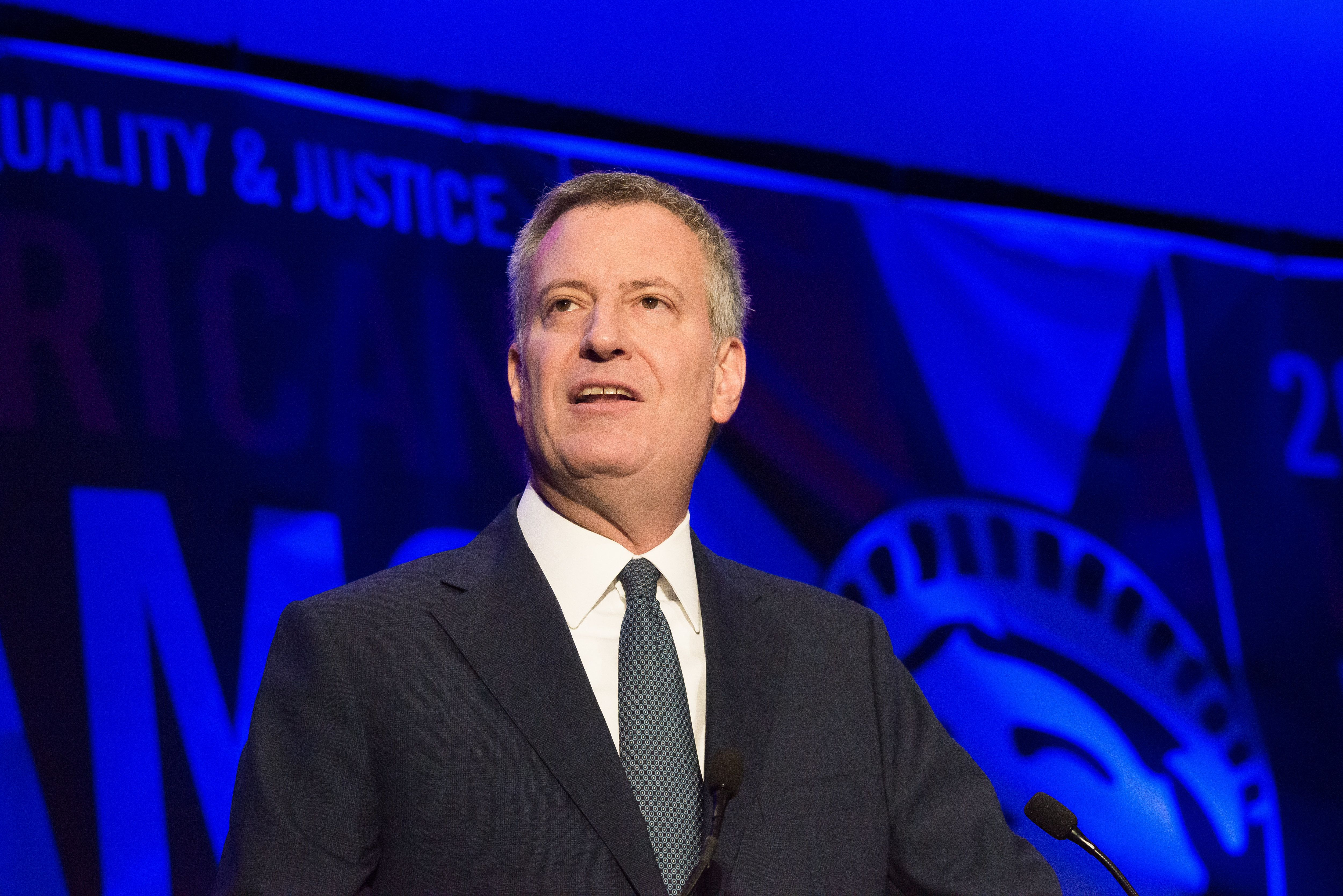 MARRIOTT HOTEL, BROOKLYN, NY, UNITED STATES - 2015/12/14: Mayor Bill de Blasio delivers remarks at the National Immigration Integration Conference. On the second day of the National Immigration Integration Conference held at the Marriott Hotel in Downtown Brooklyn, NYC Mayor Bill de Blasio delivered a keynote speech, announcing the city's commitment to welcoming newly-arrived Syrian refugees and the advent of the ActionNYC program seeking nationwide immigration reform. (Photo by Albin Lohr-Jones/Pacific Press/LightRocket via Getty Images)