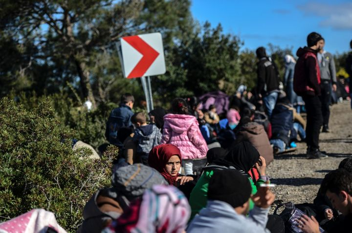 There was no letup in the number arrivals to Greece's outlying islands, either. Migrants and refugees try to reach the Greek island of Lesbos from Dikili, western Turkey.