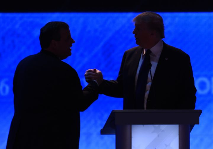 Business magnate Donald Trump, right, and New Jersey Gov. Chris Christie (R), left, shake hands in February during a break in