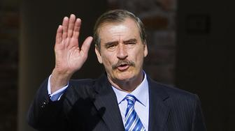 Former Mexican President Vicente Fox waves to photographers during the San Cristobal Summit, organized by the International Democratic Centre (IDC) he presides, at the Fox Centre in San Cristobal, Guanajuato State, on November 7, 2008. In the meeting, Fox along with presidents Felipe Calderon of Mexico and Alvaro Uribe of Colombia, the leader of the Popular Party of Spain, Mariano Rajoy, and the Prime Minister of Croatia, Ivo Sanader, and delegates from across the world, will discuss the alliance and strengthening of political parties that share 'centre humanist' principles, according to the IDC.  AFP PHOTO/Luis Acosta (Photo credit should read LUIS ACOSTA/AFP/Getty Images)